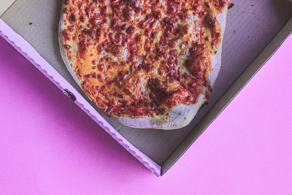 pizza on white and pink box