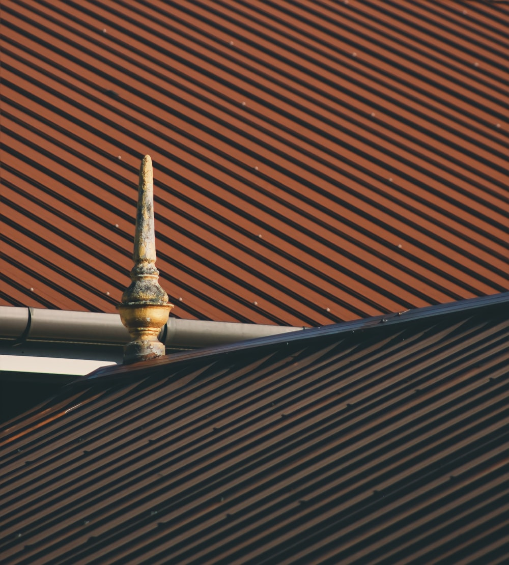 brown roof with white and gold tower