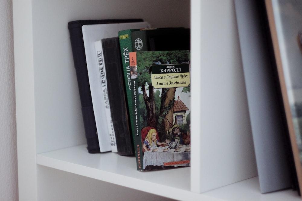 black and white book on white shelf