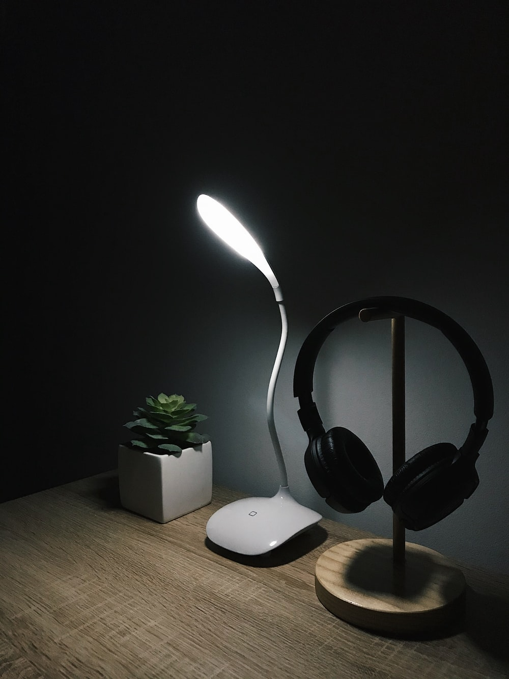 black wireless headphones on brown wooden table
