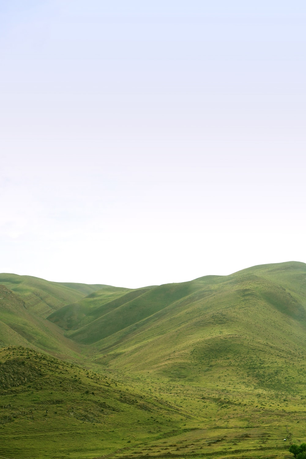 green mountains under white sky during daytime
