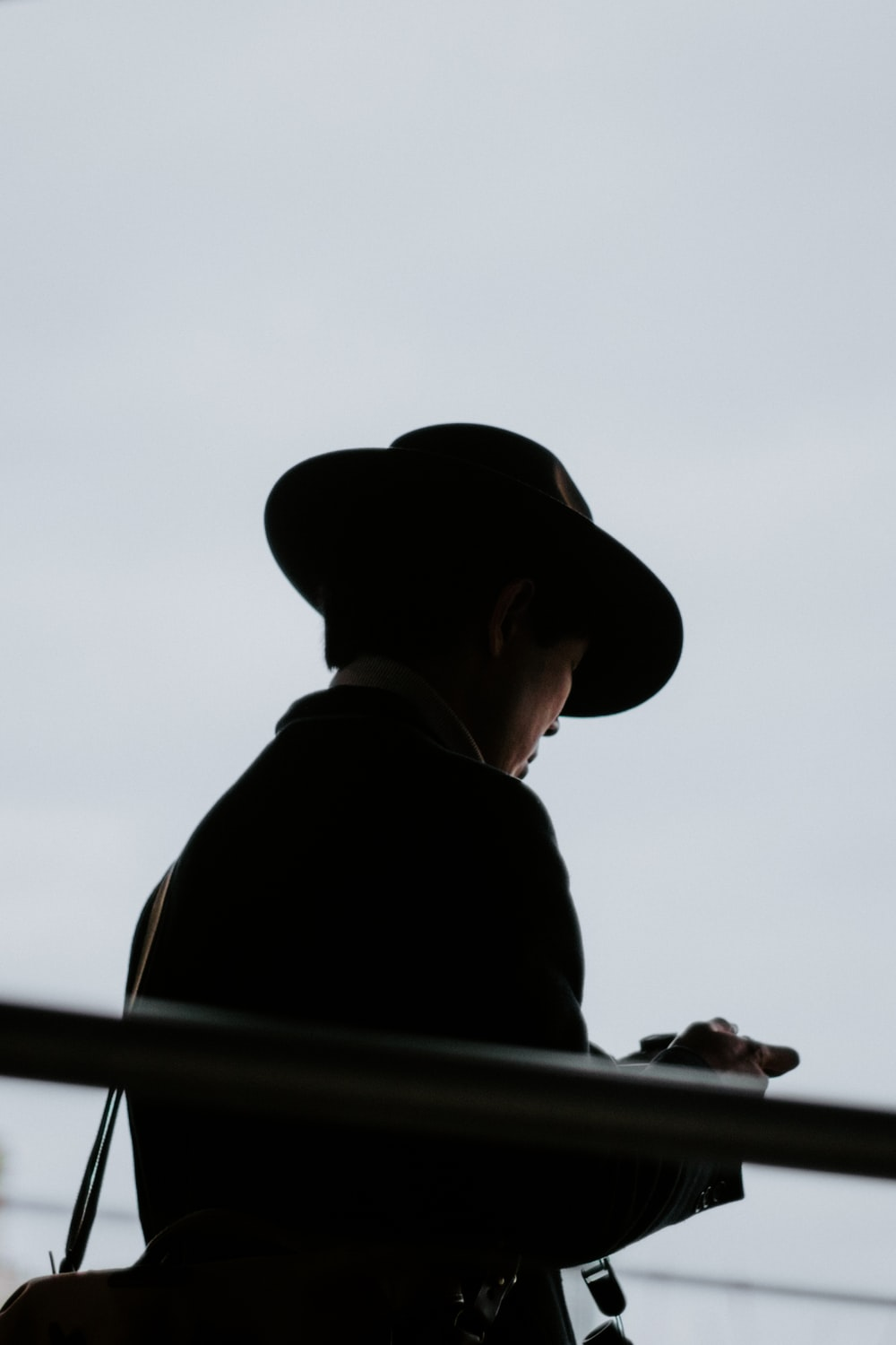 man in black hat and black shirt