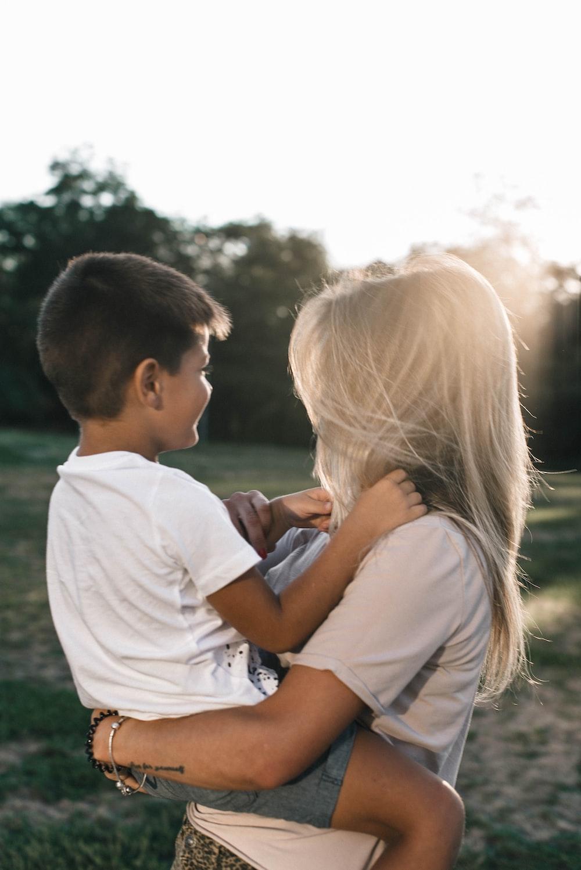 man in white shirt kissing woman in white shirt