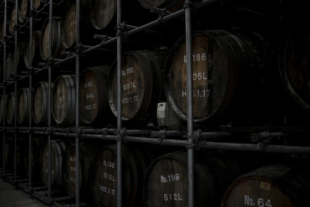 brown wooden barrels on brown wooden shelf