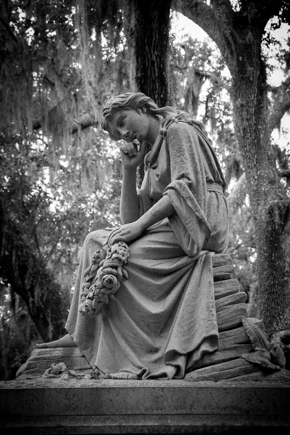 woman in dress statue in grayscale photography