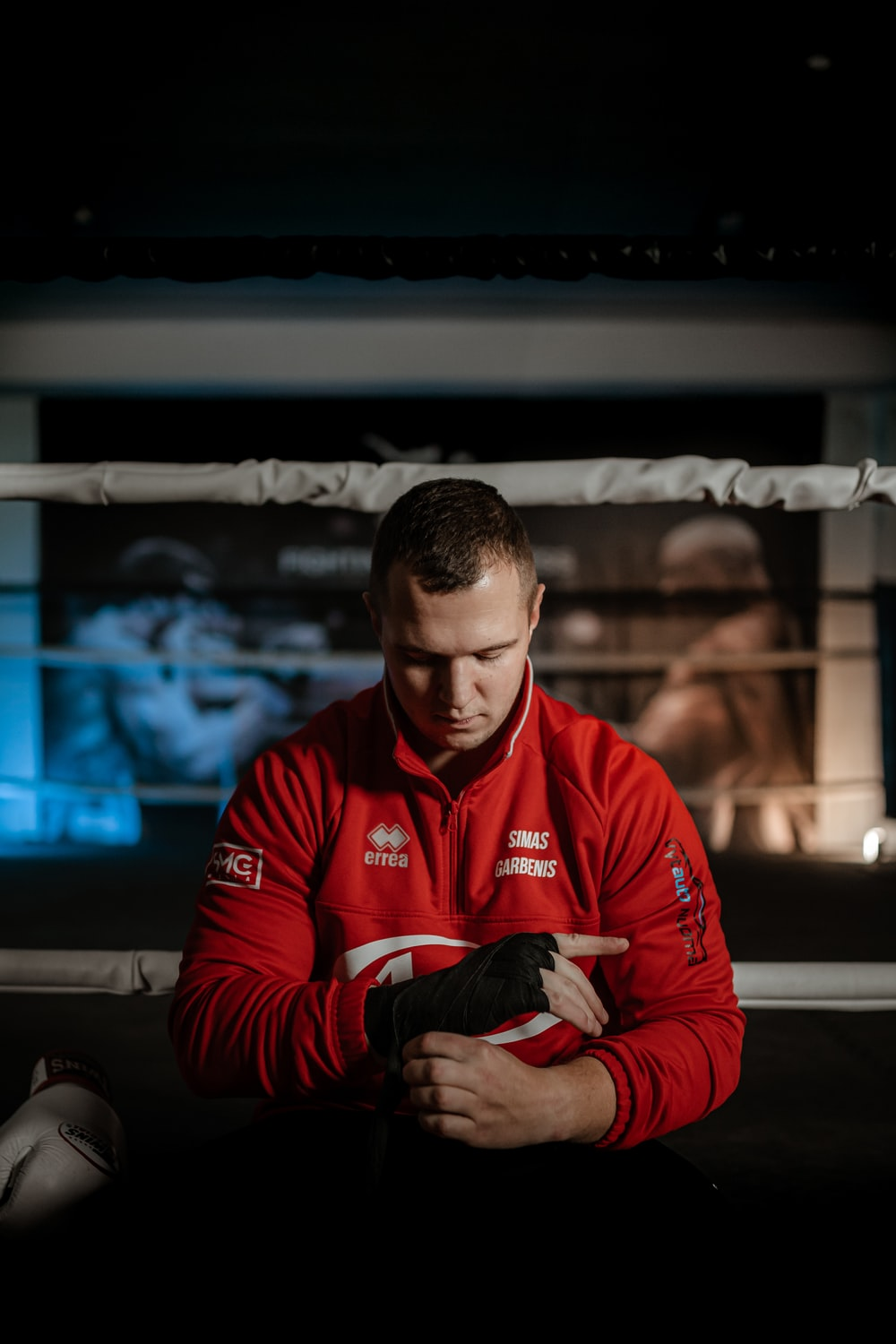 man in red and black adidas jacket