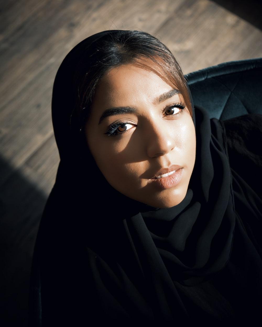 woman in black hijab taking selfie