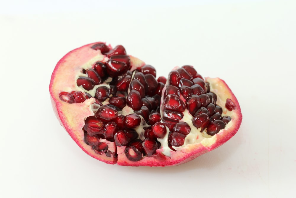 red and black fruit on white surface