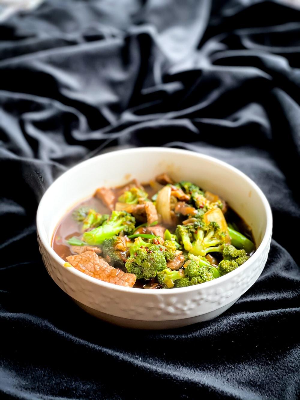 green vegetable in white ceramic bowl