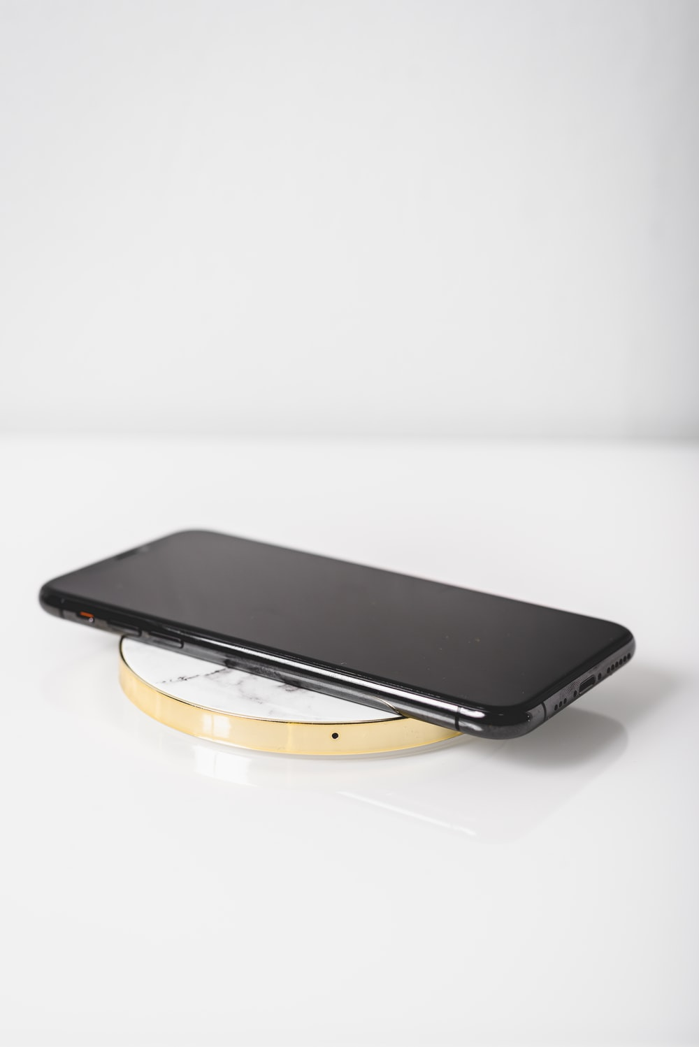 black android smartphone on white surface