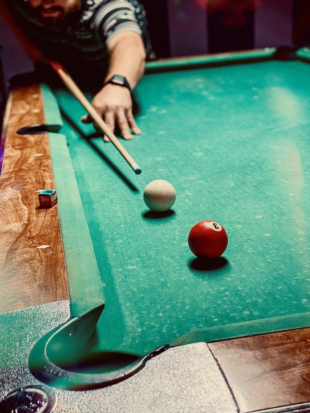 red tomato on green billiard table