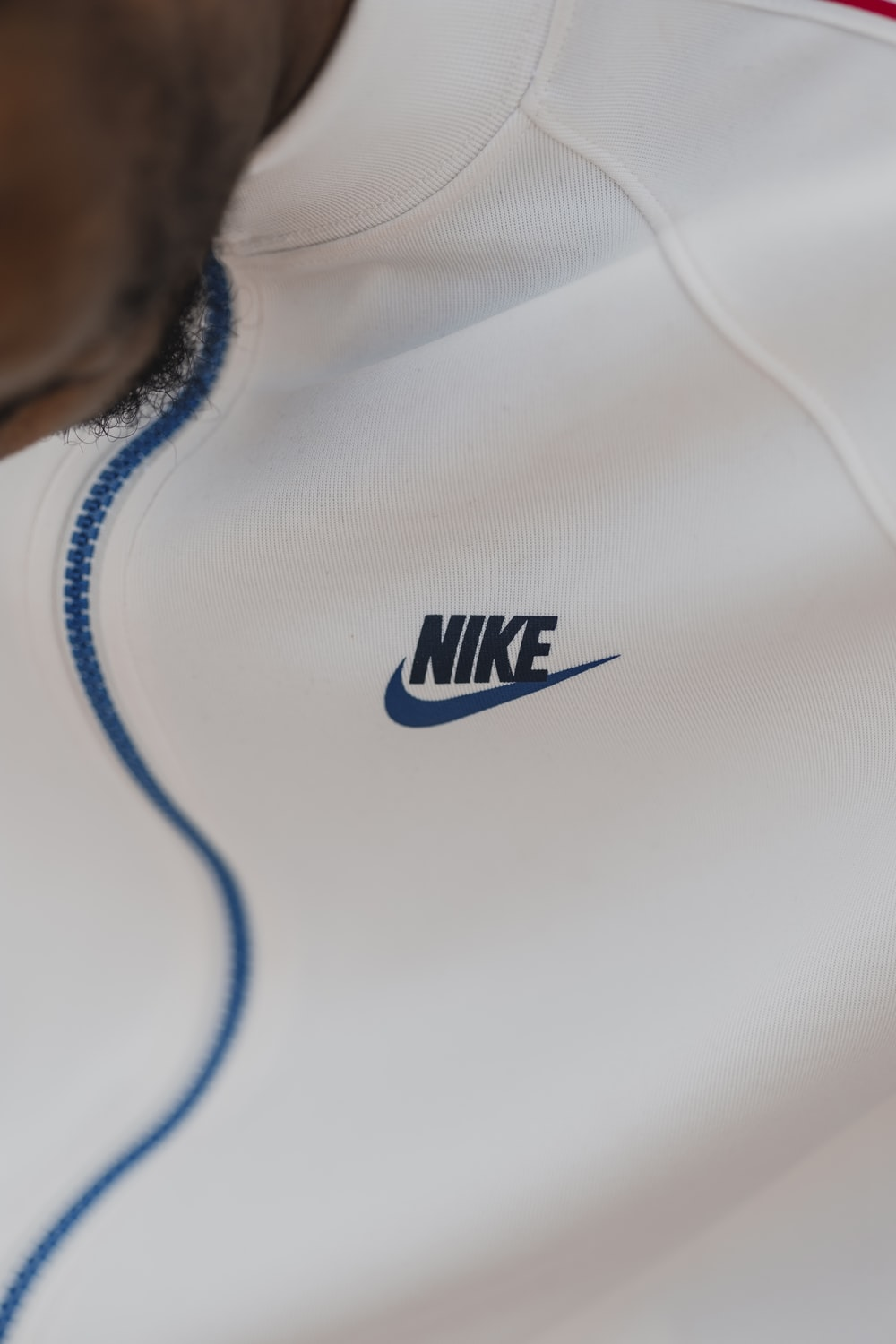 person in white nike crew neck shirt