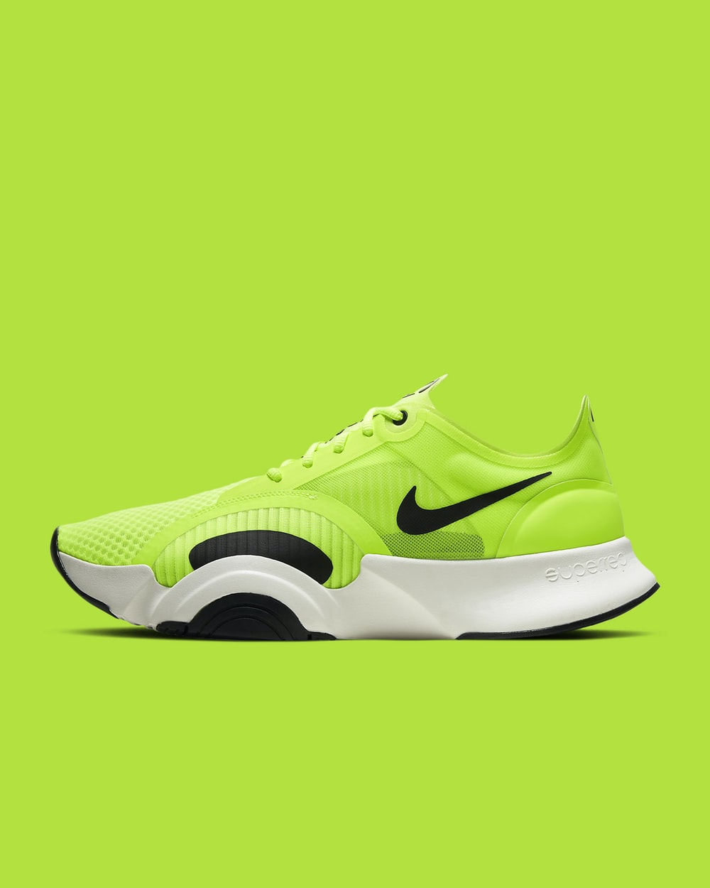 green and black nike athletic shoe