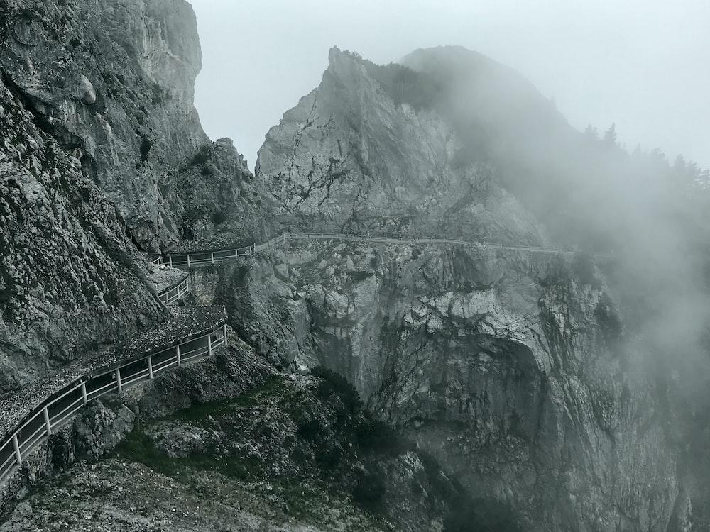 gray wooden bridge on mountain