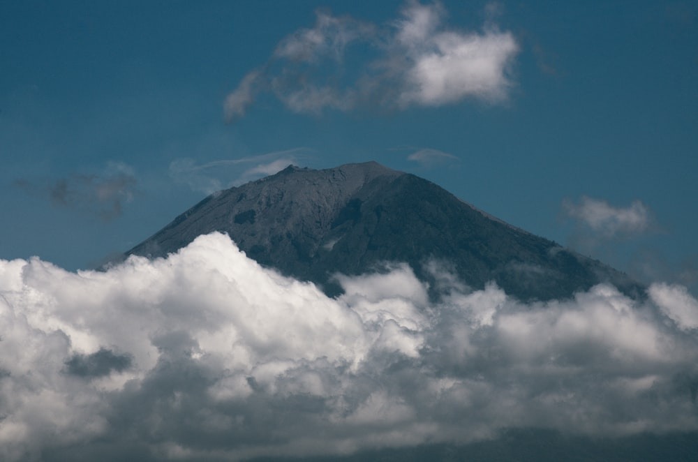 black and white mountain under blue sky and white clouds during daytime