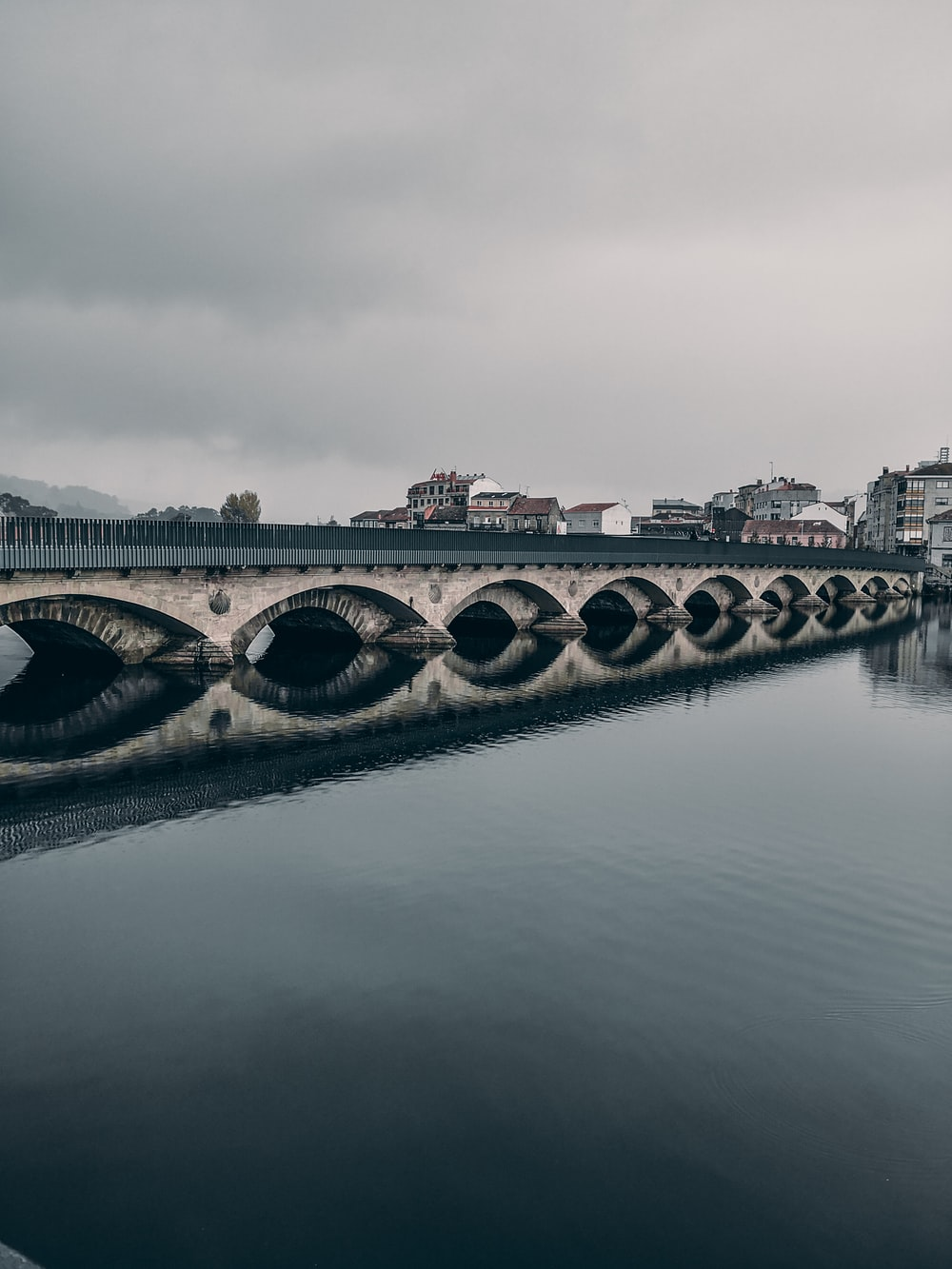 gray concrete bridge over river