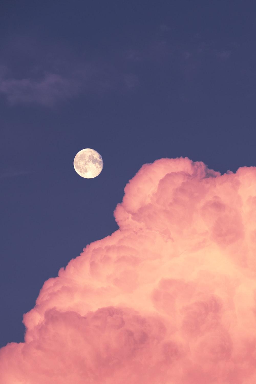 full moon over orange clouds