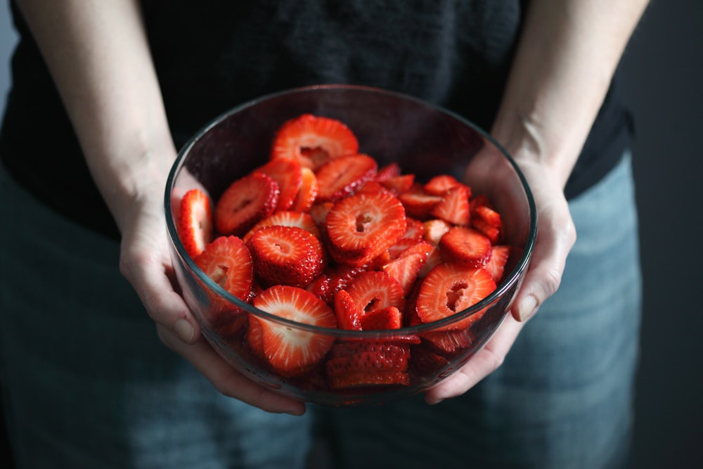 strawberries in clear glass bowl