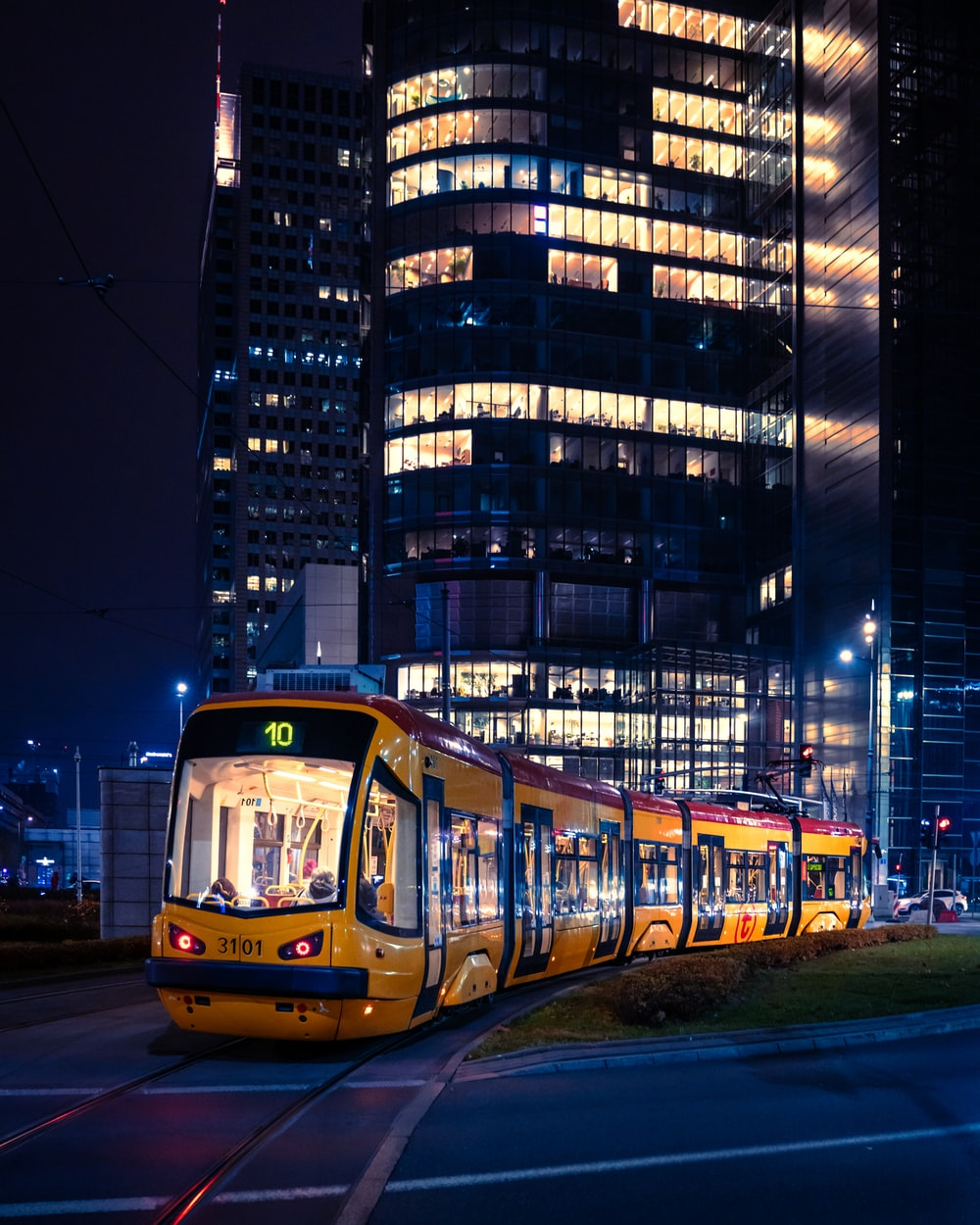 yellow and black tram on road during night time