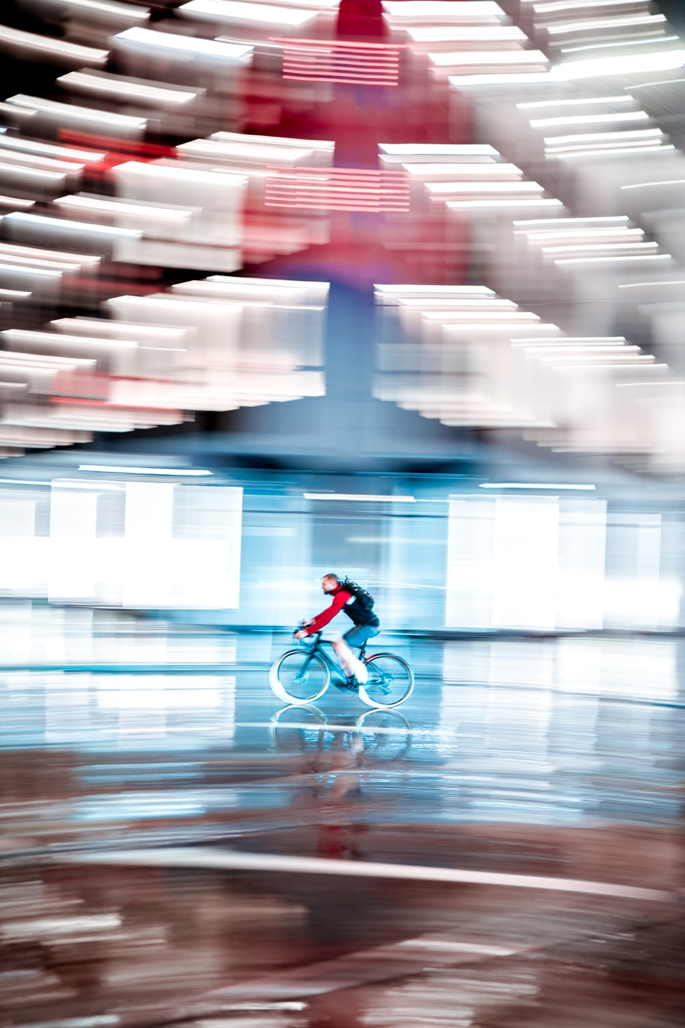 man in red jacket riding bicycle