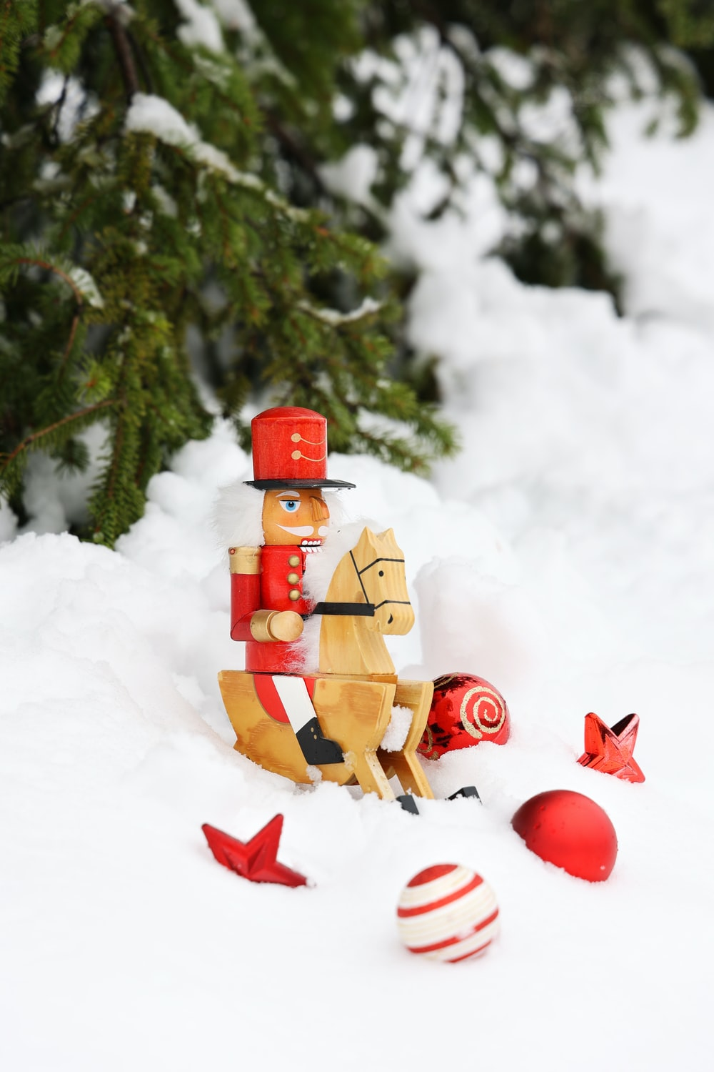 red and brown lego minifig on snow