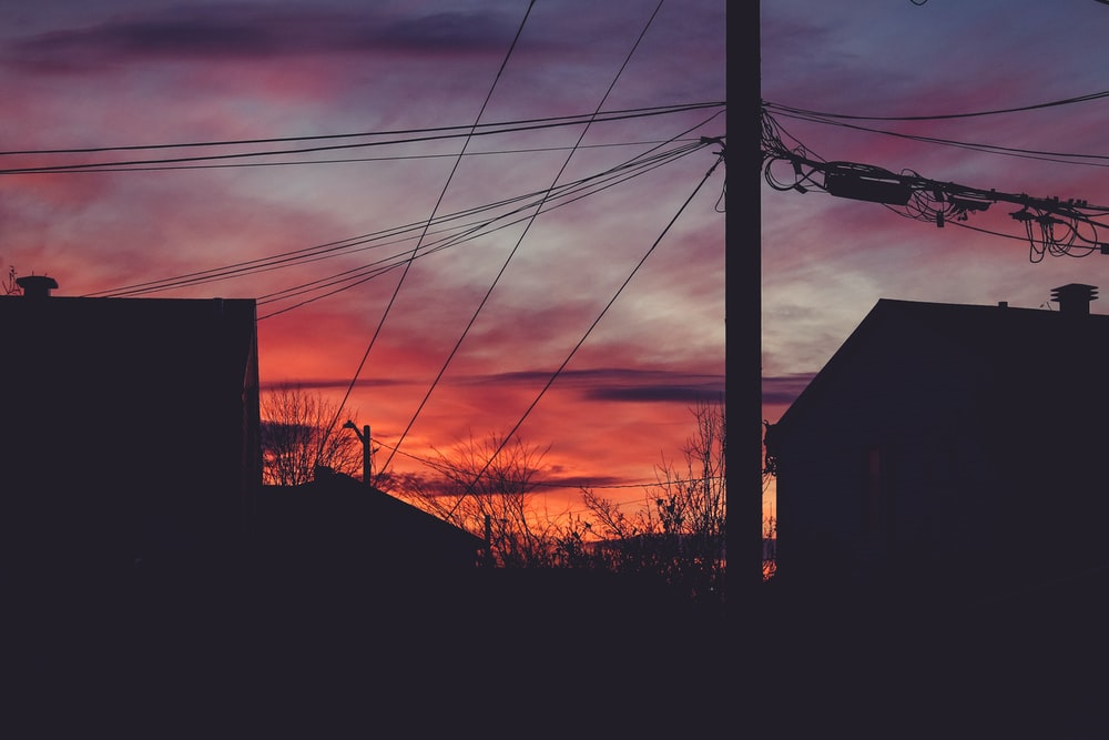 silhouette of houses during sunset