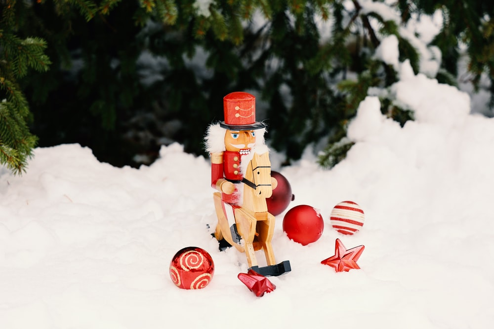 red and brown robot toy on snow
