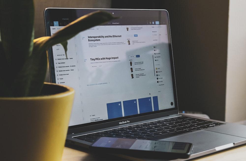 black and silver laptop computer beside yellow ceramic mug