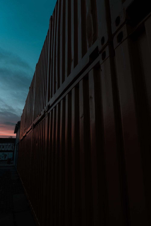 black steel fence under blue sky during daytime