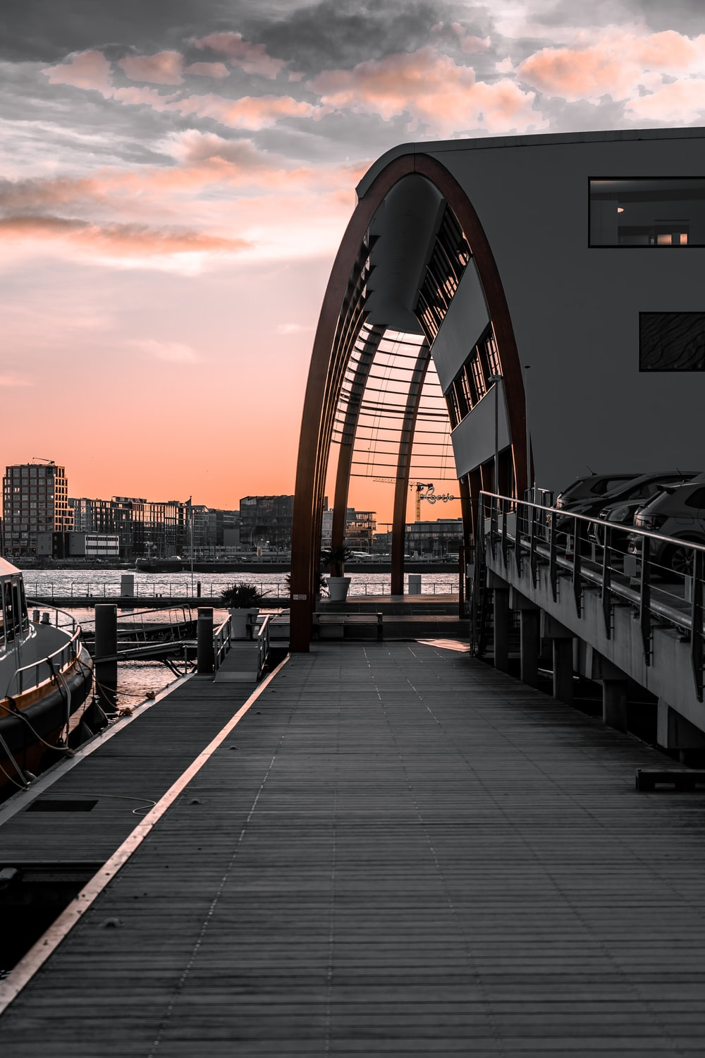 white and black boat on dock during sunset