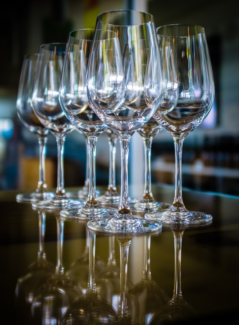 clear wine glasses on black table