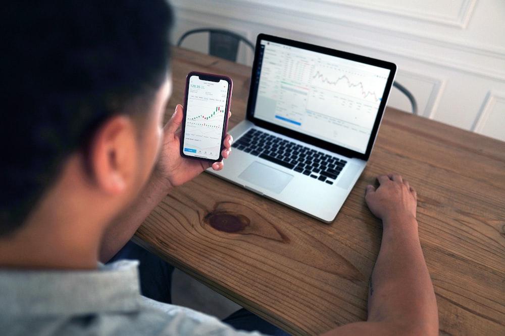person holding iphone 6 near macbook pro photo – Free Electronics Image on  Unsplash