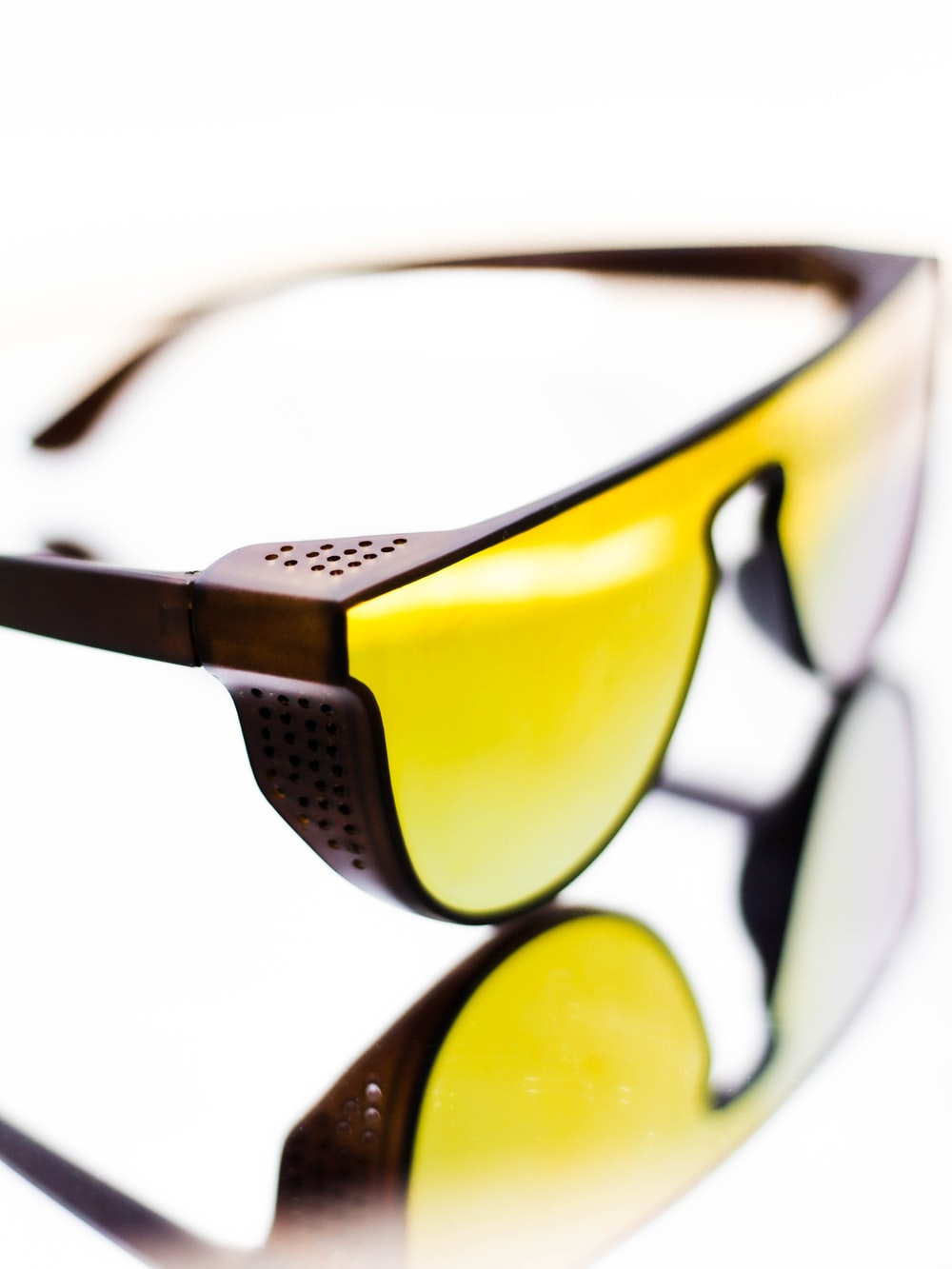 black framed sunglasses with yellow lens