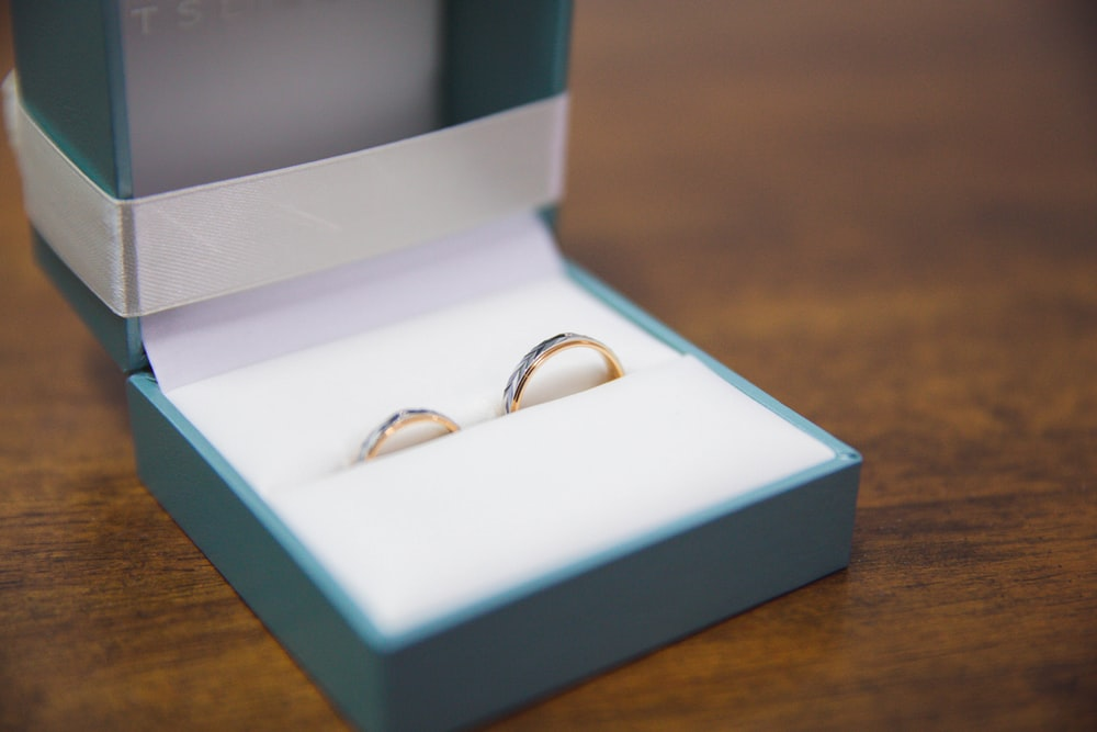 silver and gold rings in box