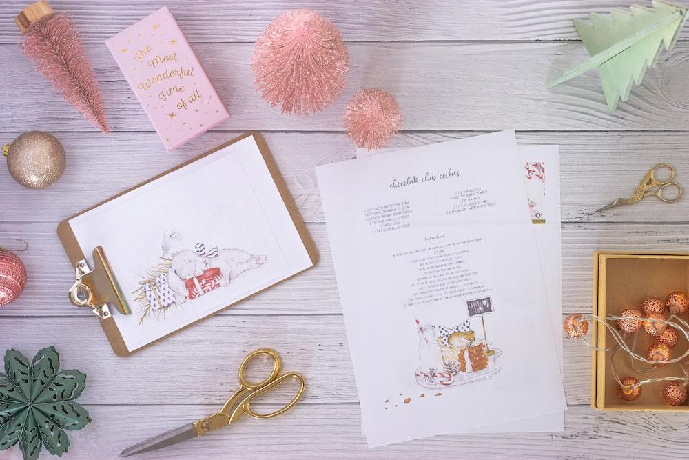 white printer paper beside pink yarn