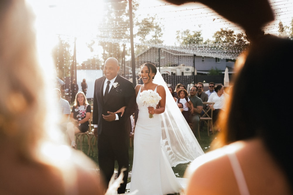 bride and groom standing on the street during daytime