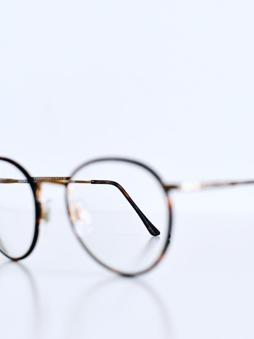 silver framed eyeglasses on white background