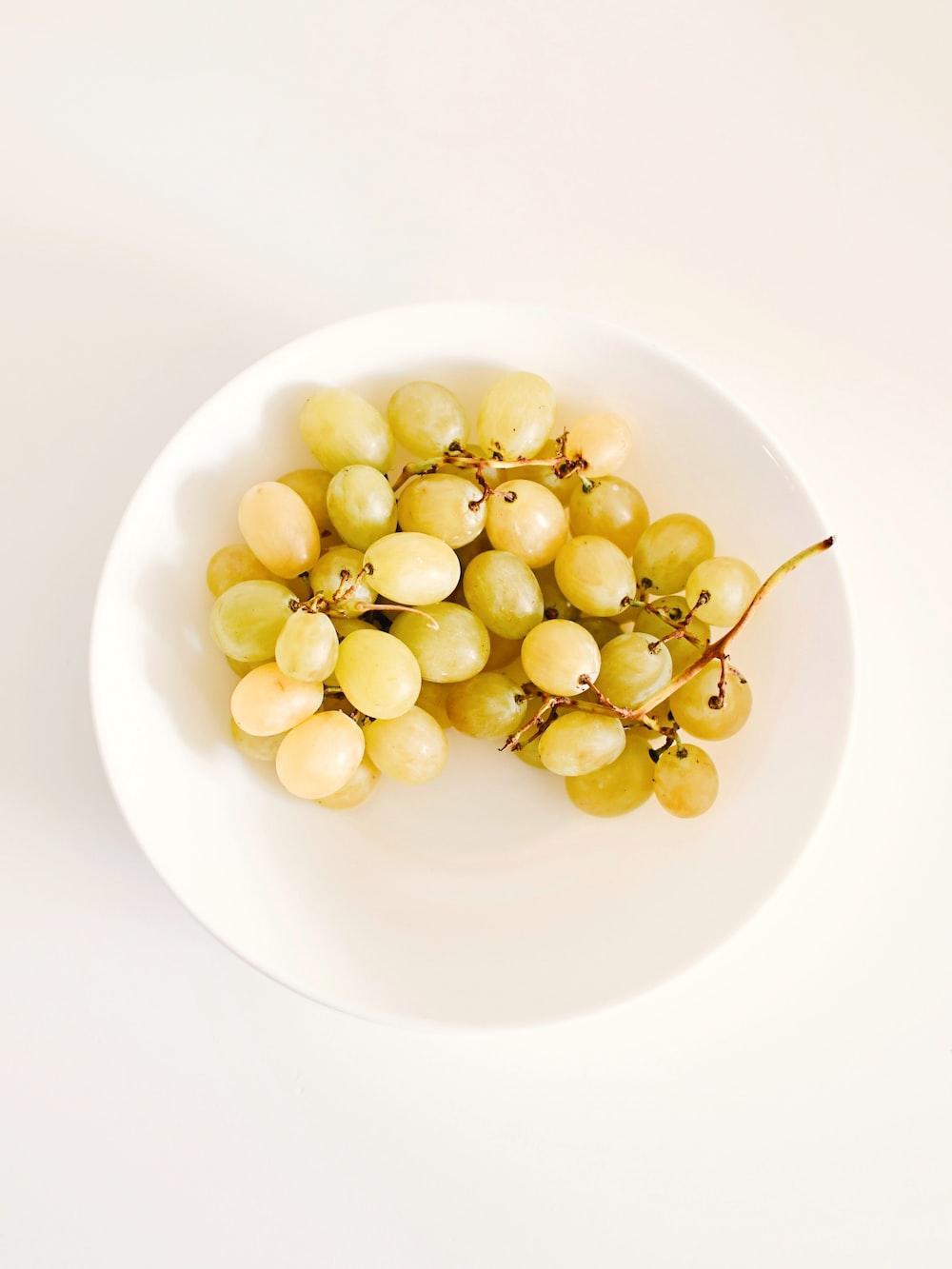 yellow round fruits on white ceramic plate