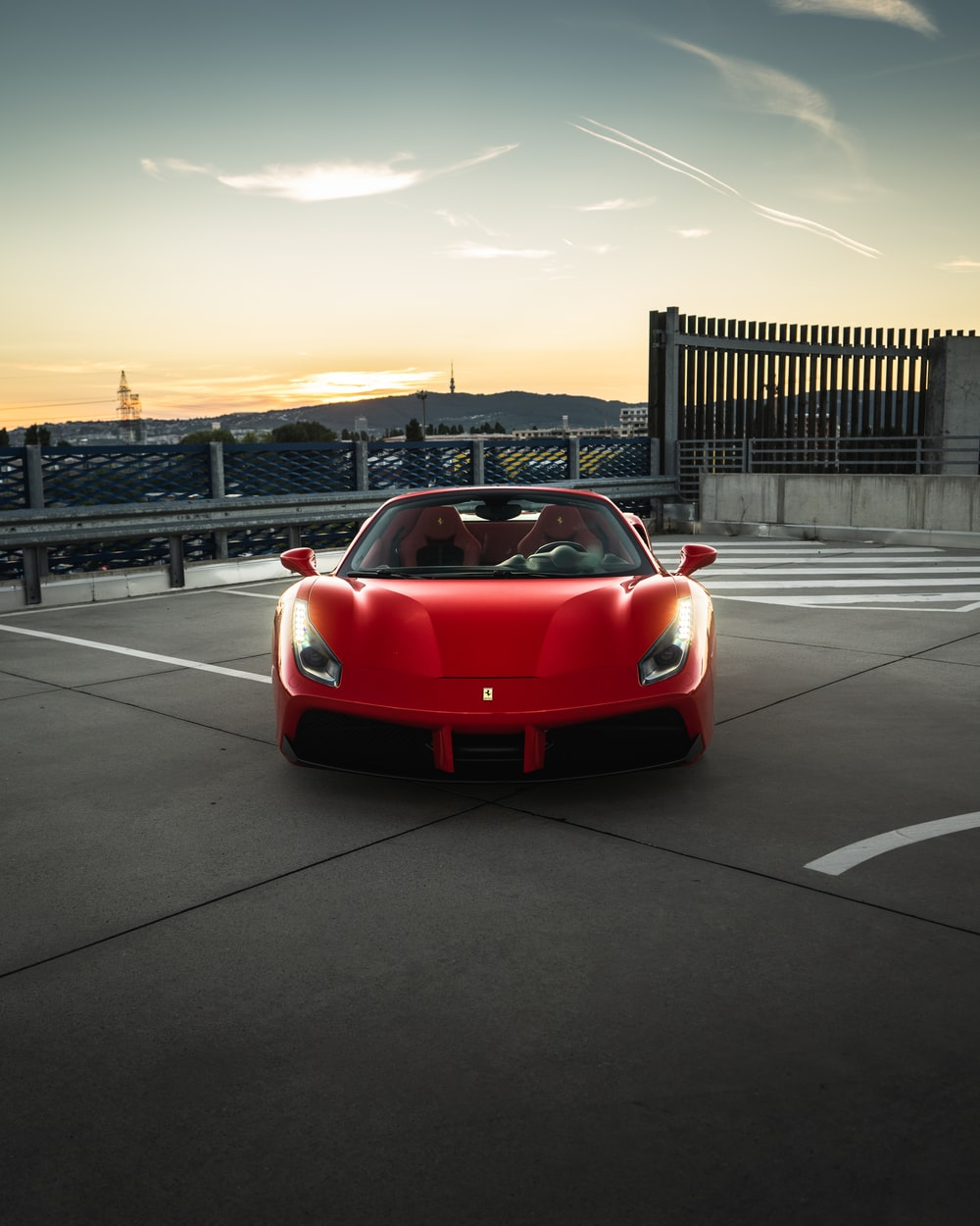 red ferrari sports car on road during daytime