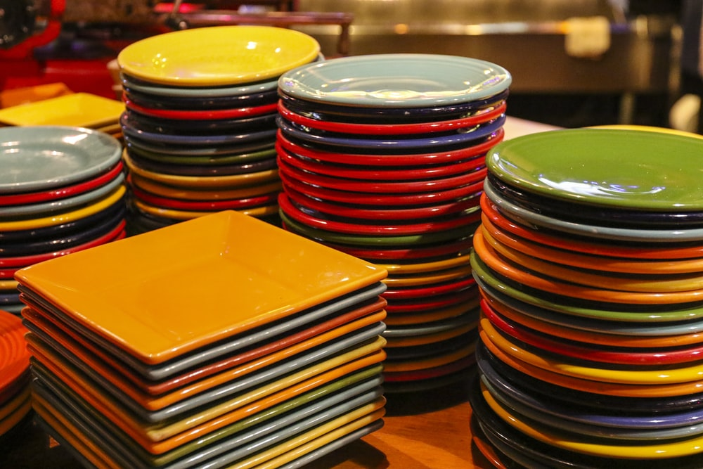 yellow green red and blue ceramic bowls