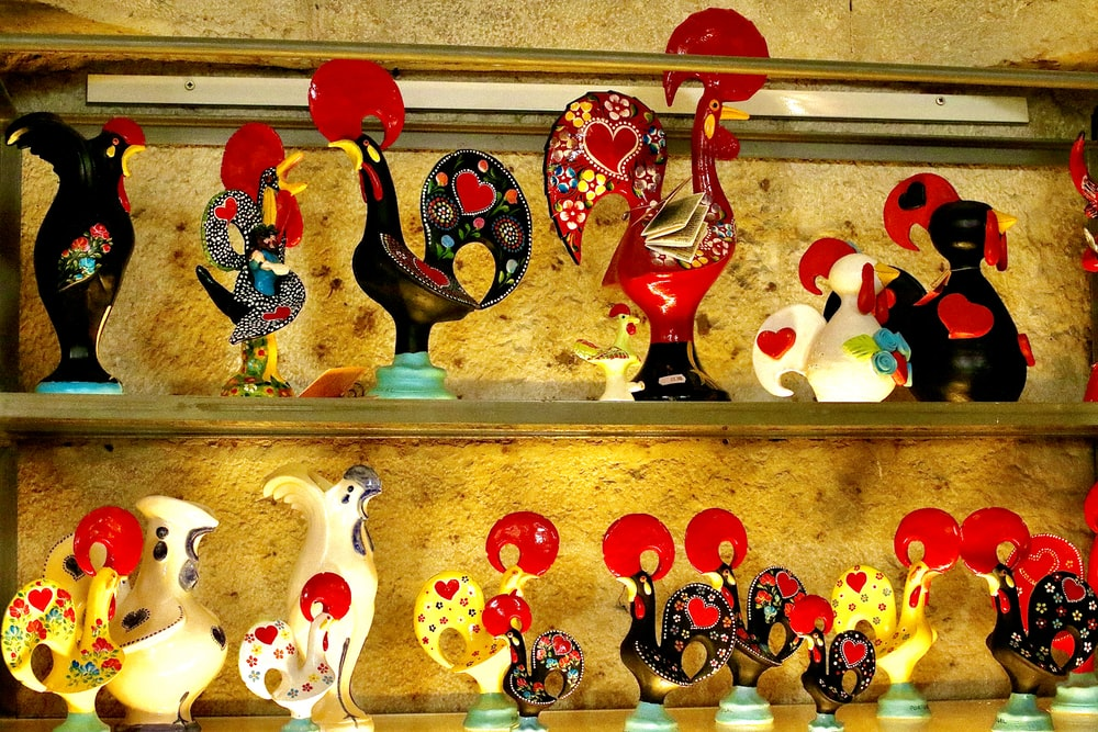 red white and black ceramic figurines
