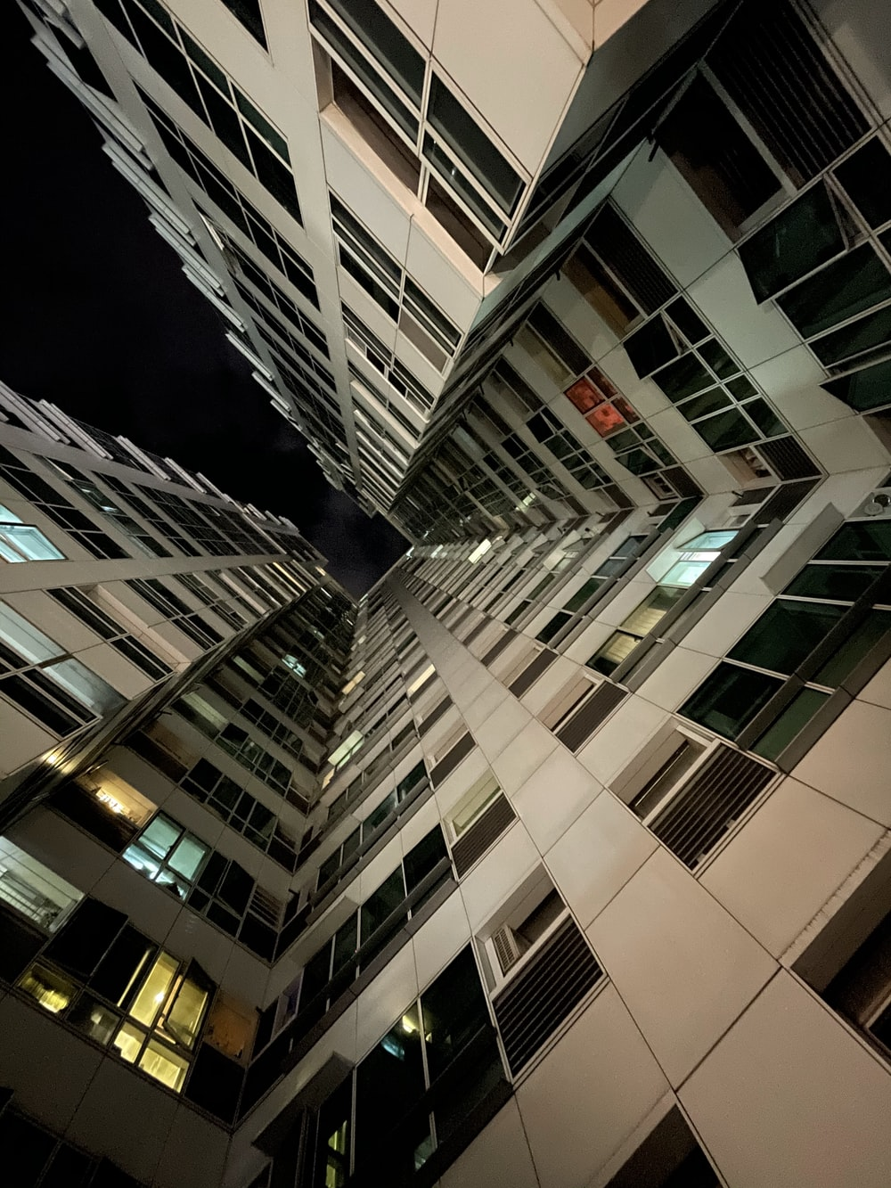 white and black concrete building during night time