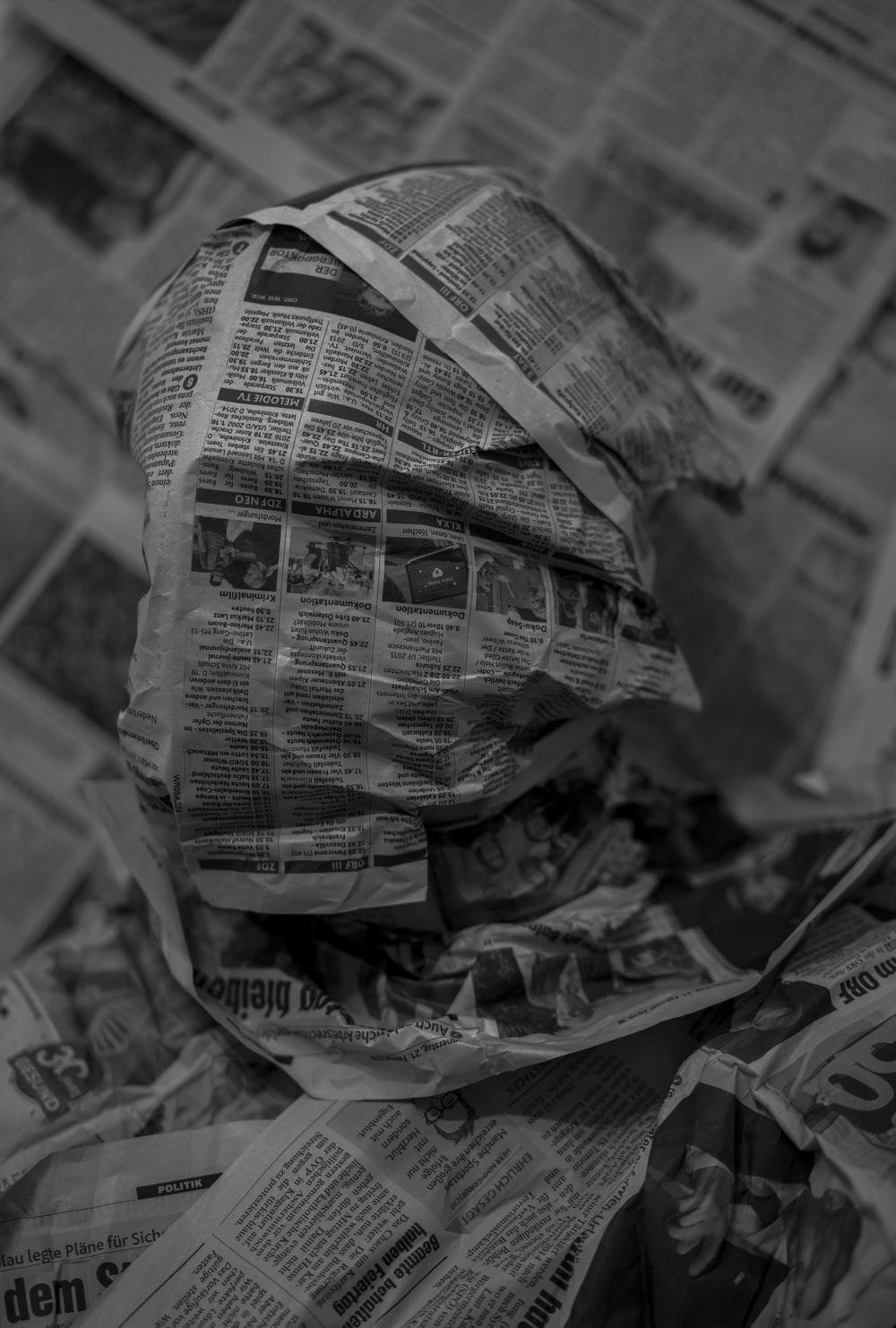 grayscale photo of a newspaper