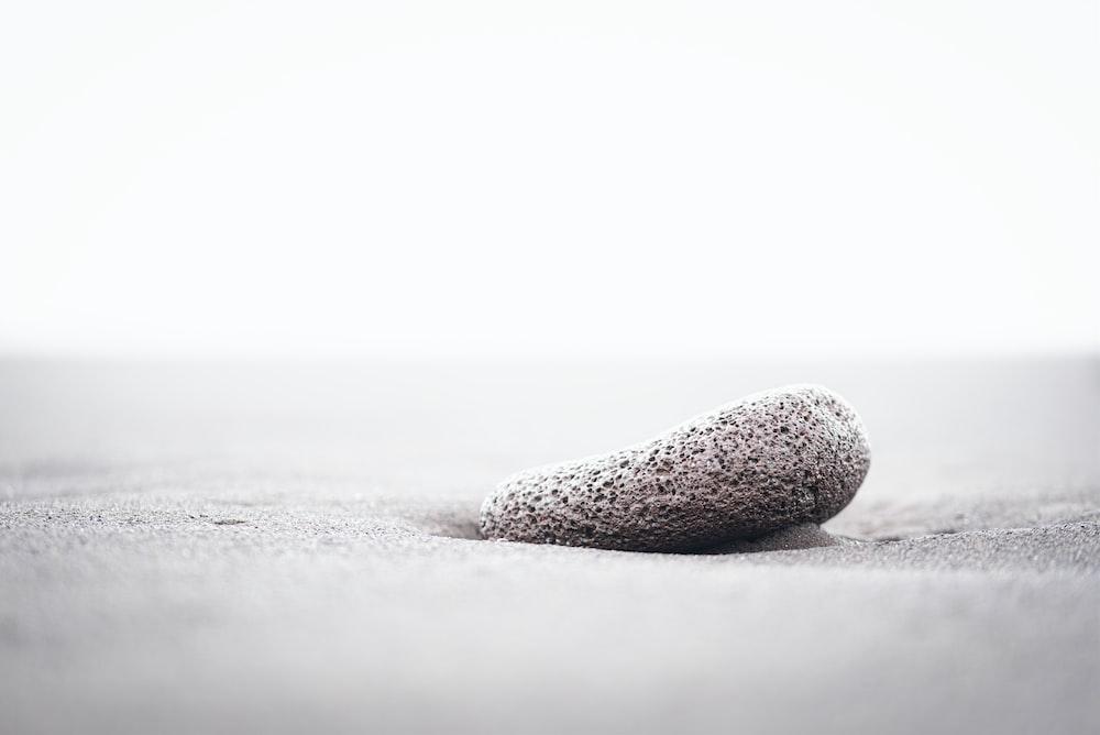 black and white stone on white snow