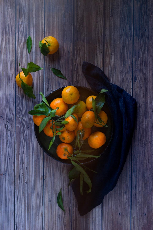 orange fruits on blue ceramic plate