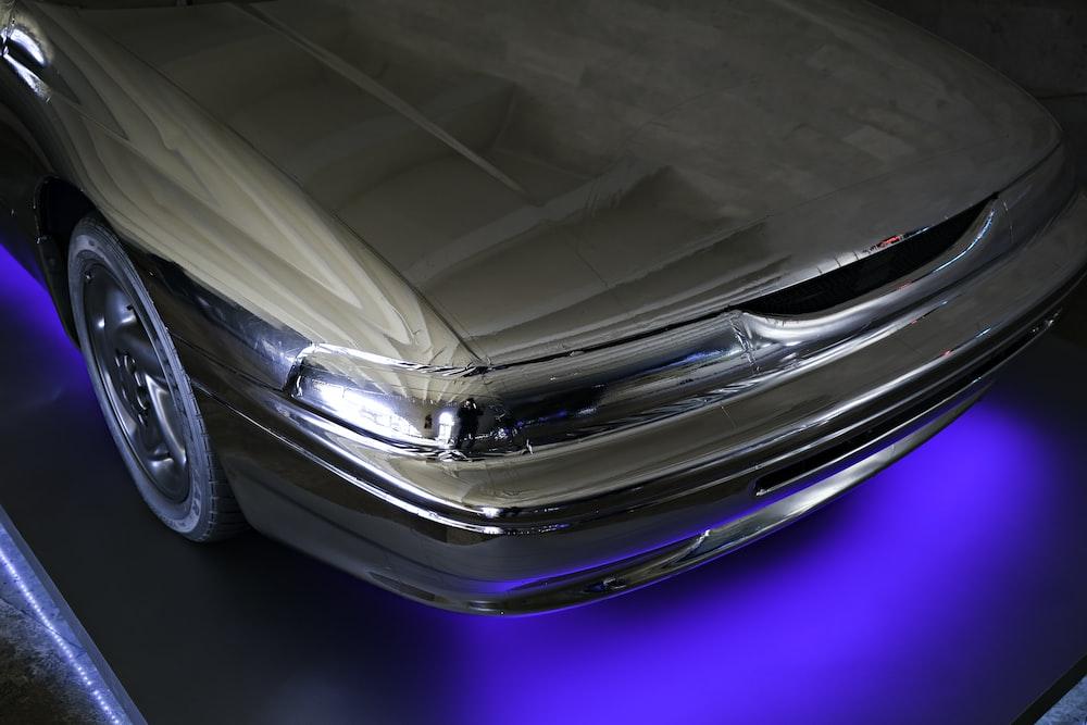 silver car on blue floor