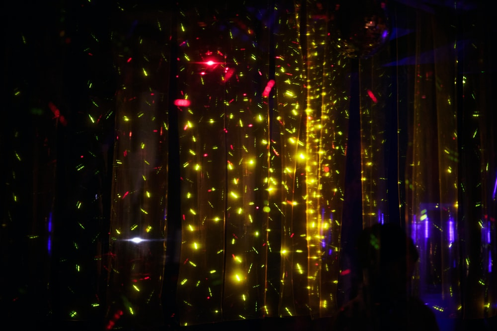 yellow string lights on black background