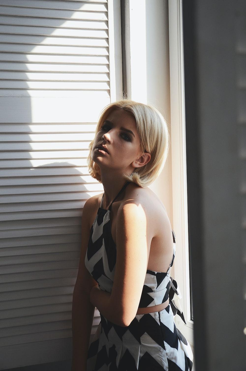 woman in black and white polka dot bikini top