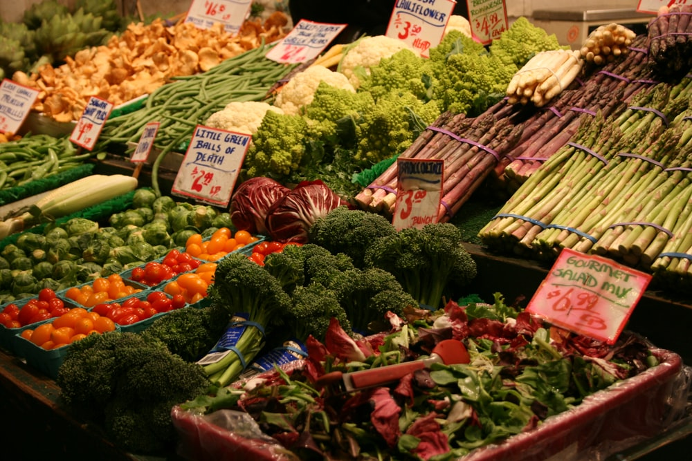 green and brown vegetables on display