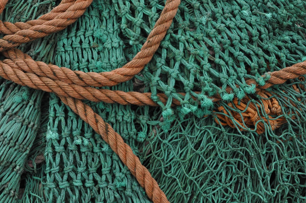 brown rope on green textile